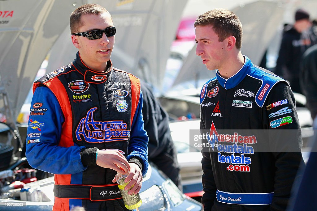 CJ Faison (L), driver of the #39 Sherwin-Williams Chevrolet, talks with Dylan Presnell (R), driver of the #26 American Mountain Rentals Chevrolet, in the garage area during practice for the NASCAR K&N Pro Series East DRIVE4COPD 125 at Bristol Motor Speedway on March 14, 2013 in Bristol, Tennessee.