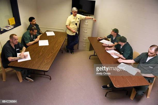 Faith and Citizens volunteer coordinator Tracy Swindler center talks with inmates during a parenting class at the Colorado State Penitentiary May 03...