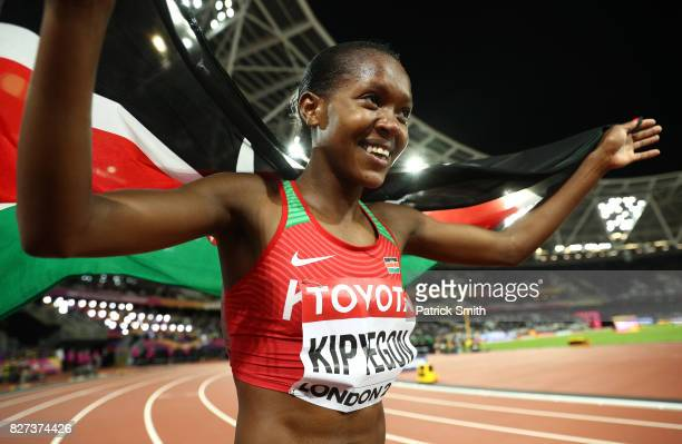 Faith Chepngetich Kipyegon of Kenya gold celebrates with the Kenyan flag after the Women's 1500 metres final during day four of the 16th IAAF World...