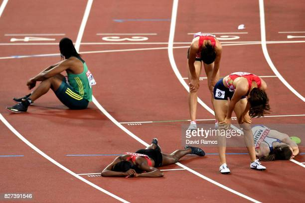 Faith Chepngetich Kipyegon of Kenya gold collapses after winning the Women's 1500 metres final during day four of the 16th IAAF World Athletics...
