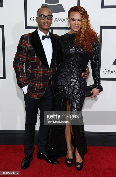 Faith Evans and guest arrive at the 56th Annual GRAMMY Awards at Staples Center on January 26 2014 in Los Angeles California