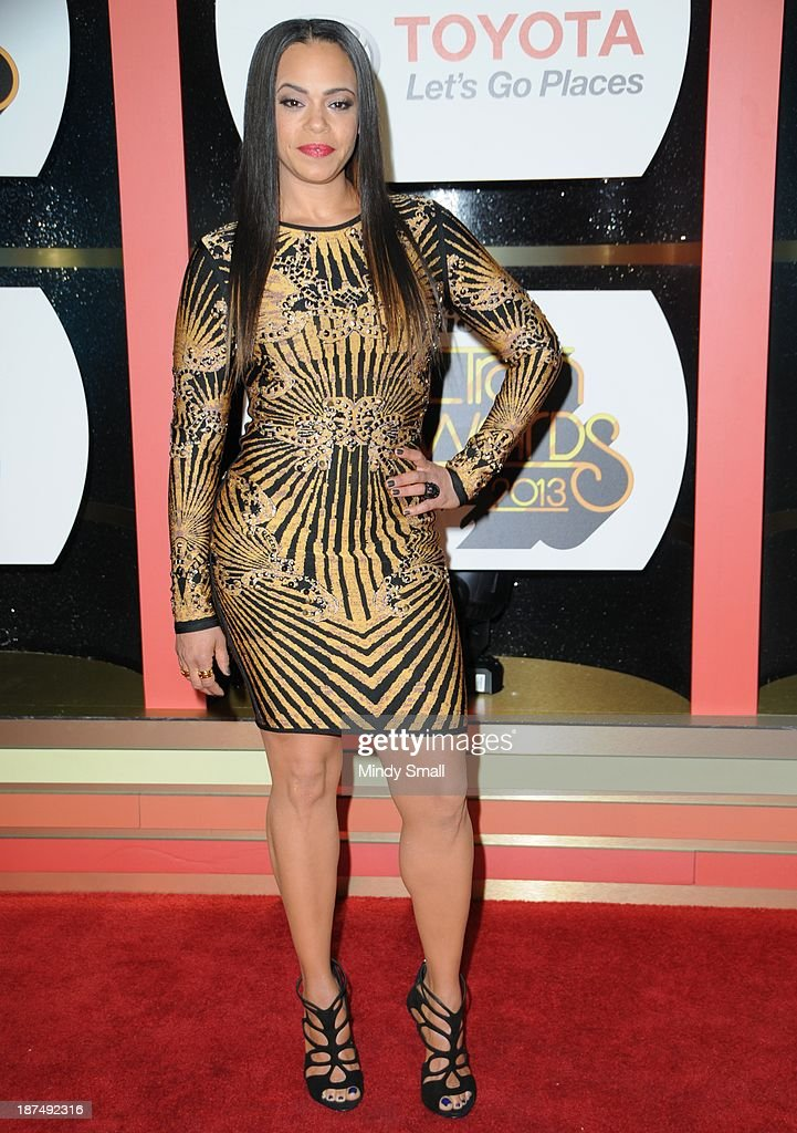 <a gi-track='captionPersonalityLinkClicked' href=/galleries/search?phrase=Faith+Evans&family=editorial&specificpeople=203286 ng-click='$event.stopPropagation()'>Faith Evans</a> arrives at the Soul Train Awards 2013 at the Orleans Hotel & Casino on November 8, 2013 in Las Vegas, Nevada.