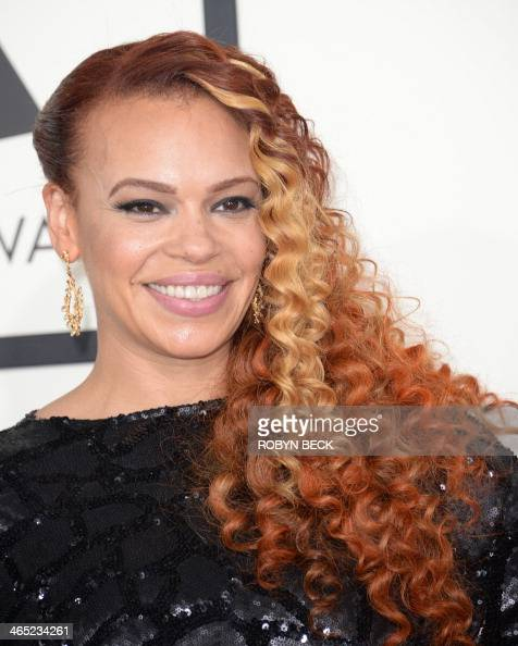 Faith Evans arrives on the red carpet for the 56th Grammy Awards at the Staples Center in Los Angeles California January 26 2014 AFP PHOTO ROBYN BECK