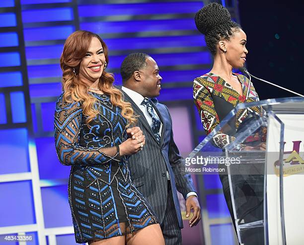 Faith Evans Junior and Michelle Williams speak at the 2015 Ford Neighborhood Awards Hosted By Steve Harvey at Phillips Arena on August 8 2015 in...