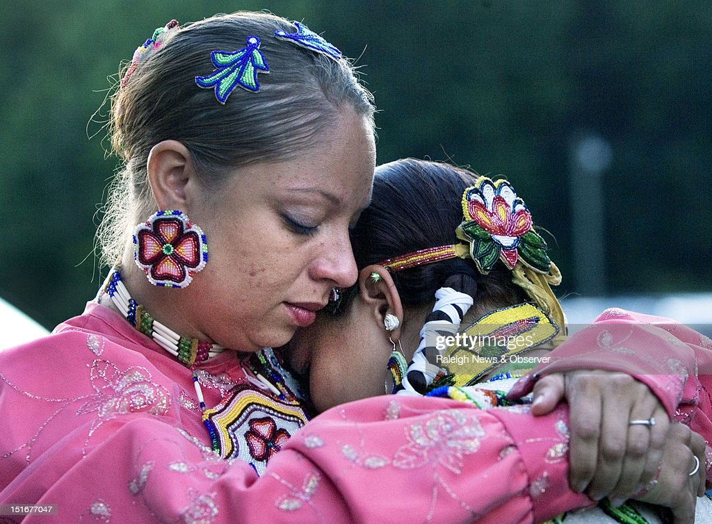 Faith Hedgepeth's cousin Consuela Richardson, left, consoles Satarah Lewis, right, during a candlelight vigil at the Haliwa-Saponi Tribal School in Hollister, North Carolina, to remember and pray for Faith Hedgepeth. A member of the Haliwa-Saponi American Indian Tribe, Hedgepeth was found dead in her Chapel Hill apartment on Friday. She was a sophomore, Biology major at UNC-Chapel Hill.