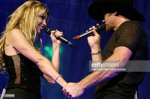 Faith Hill and her husband Tim McGraw are in touch and in tune at Madison Square Garden performance Saturday night