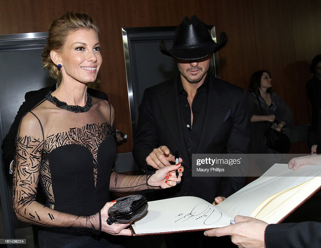 <a gi-track='captionPersonalityLinkClicked' href=/galleries/search?phrase=Faith+Hill&family=editorial&specificpeople=175933 ng-click='$event.stopPropagation()'>Faith Hill</a> (L) and <a gi-track='captionPersonalityLinkClicked' href=/galleries/search?phrase=Tim+McGraw&family=editorial&specificpeople=202845 ng-click='$event.stopPropagation()'>Tim McGraw</a> pose at the GRAMMY Charities Signing Booth during the 55th Annual GRAMMY Awards at STAPLES Center on February 10, 2013 in Los Angeles, California.