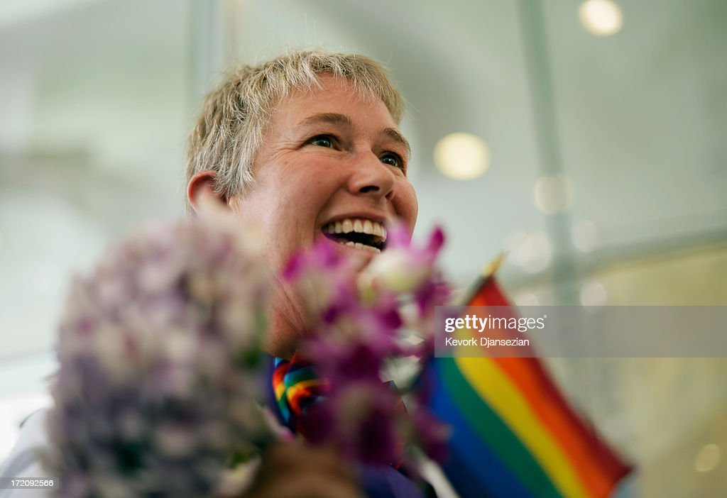 Faith Kassan, 46, holds a rainbow colored wedding corsage before marrying her partner Jennifer Ehrman, 43, at a wedding ceremony on July 1, 2013 in West Hollywood, California. The U.S. Ninth Circuit Court of Appeals lifted California's ban on same-sex marriages just three days after the Supreme Court ruled that supporters of the ban, Proposition 8, could not defend it before the high court. California Gov. Jerry Brown ordered all counties in the state to begin issuing licenses immediately.