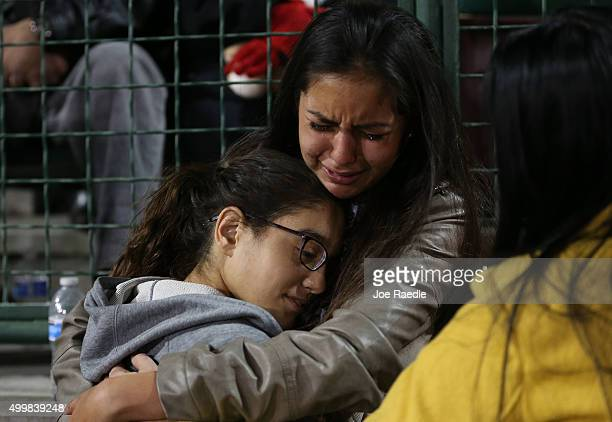 Faith Rodriguez is comforted as she cries during a vigil at the San Manuel Stadium to remember those injured and killed during the shooting at the...