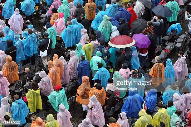 Faithful attend the Easter Mass given by Pope Francis at St Peter's Square on April 5 2015 in Vatican City Vatican Tens of thousands of people...