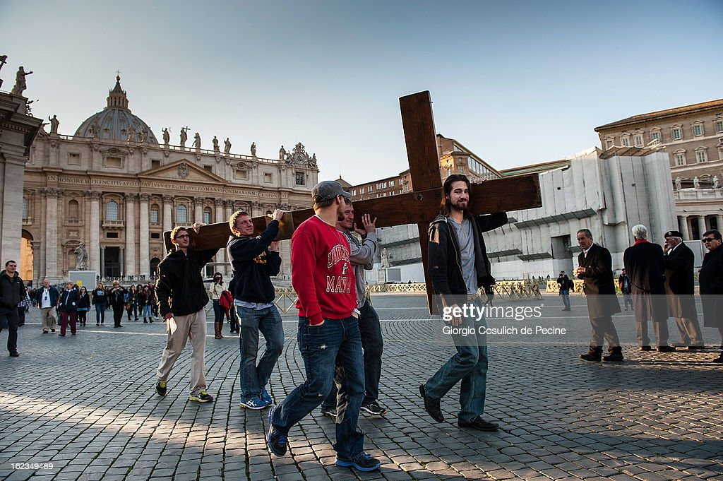 Faithful carry a cross as they gather to St. Peters' Square on February 19, 2013 in Vatican City, Vatican. Pope Benedict XVI will hold his last weekly public audience on February 27 at St Peter's Square after announcing his resignation earlier last week.