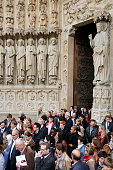 Faithful coming out of NotreDame de Paris cathedral