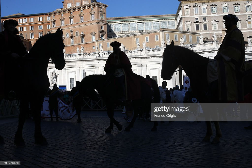 Faithful dressed as the three Magi (the Three Wise Men) gather in St Peter's Square during the Feast of the Epiphany attend the Pope Francis' Angelus blessing on January 6, 2015 in Vatican City, Vatican. During his homily, Pope Francis focused on the journey taken by the three wise men, which is celebrated today, and encouraged Catholics to keep a strong faith.