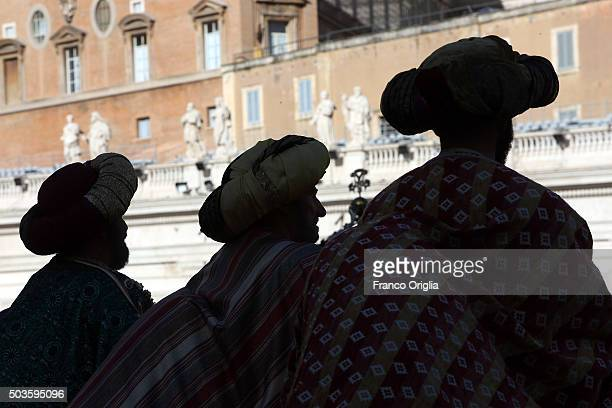 Faithful dressed as the three Magi gather in St Peter's Square during the Feast of the Epiphany attend the Pope Francis' Angelus blessing on January...