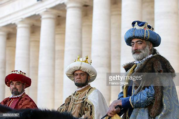 Faithful dressed as three Magi gathered in St Peter's Square during the Feast of the Epiphany attend the Pope Francis' Angelus blessing on January 6...