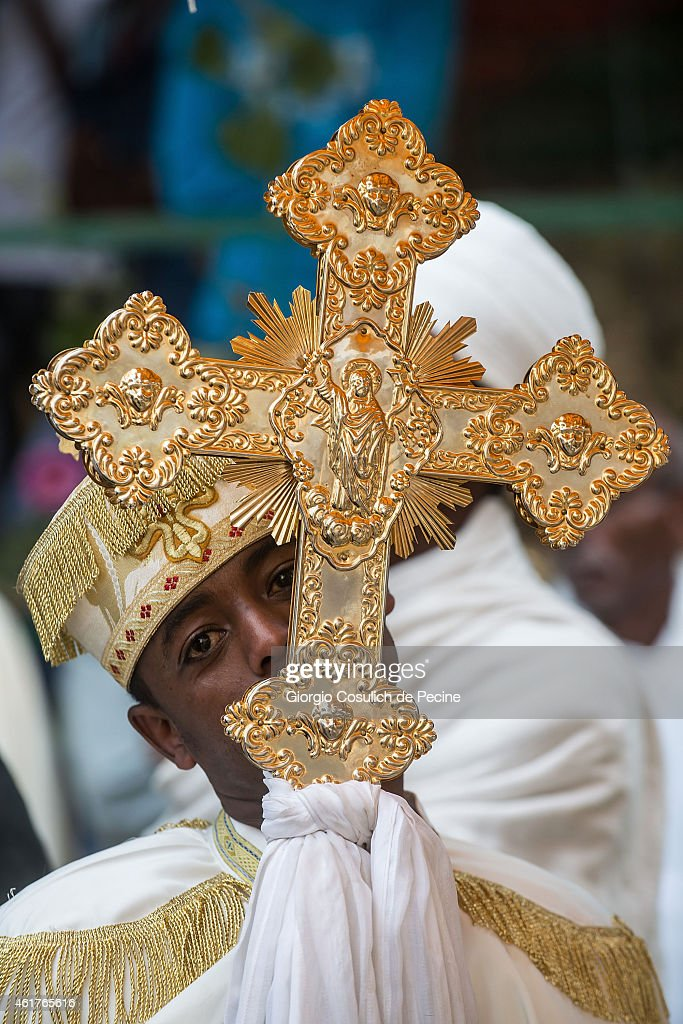 A faithful dressed with traditional clothes kisses the orthodox cross as he attends the Timkat celebration on January 18, 2015 in Addis Ababa, Ethiopia. The Timkat is the Ethiopian Orthodox celebration of Epiphany and It is celebrated on January 18-19, following the Ethiopian calendar. Timkat celebrates the baptism of Jesus in the Jordan River.