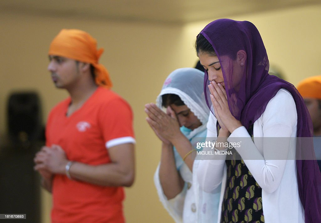Faithful from the Paris Sikh community pray on September 22, 2013 during meditation at the largest gurdwara or Sikh temple in France, located in the Paris suburb of Bobigny. France's Sikh community is ramping up a campaign for the turban to be allowed in state-funded schools amid moves to reinforce a 2004 law banning pupils from sporting religious symbols. The contentious issue pits the cherished French principle of secularity in public life and institutions against the essence of the Sikh religion, which requires followers to keep long hair as a mark of their faith and piety and a turban to cover the tresses, worn as a bun on the top of the head.