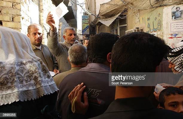 Faithful Iraqi Shia Muslims line up for Islamic advice from Grand Ayatollah Ali Sistani Iraq's preeminent Shiite Muslim cleric near the alleyway...