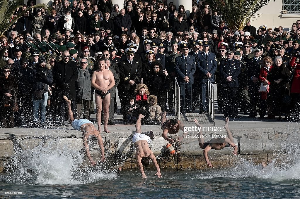 Faithful jump to the sea to retrieve a cross during the blessing of the waters marking the Epiphany Day in the city of Volos, in central Greece's region on January 6, 2012.