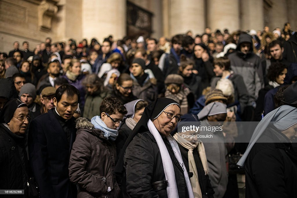 Faithful leave Saint Peters' Basilica after the celebration of the Ash Wednesday mass on February 13, 2013 in Vatican City, Vatican. The Pontiff will hold his last weekly public audience on February 27 at St Peter's Square after announcing his resignation earlier this week.
