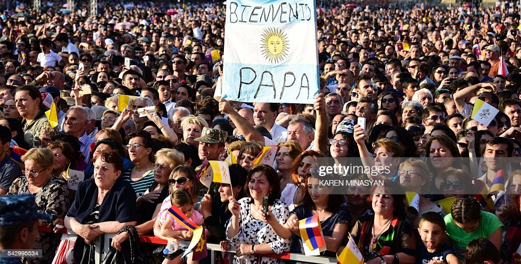 Faithful listen as Pope Francis and Catholicos of All Armenians Karekin II lead an ecumenical meeting and a prayer for peace in Yerevan's Republic Square on June 25, 2016. / AFP / KAREN