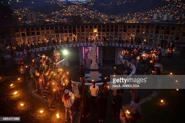 Faithful participate in a ceremony at the San Javier cemetery in the Comuna 13 shantytown in Medellin Antioquia department Colombia during the...
