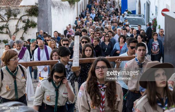 Faithful perform the Stations of the Cross procession in Rua Direita during Good Friday when the town receives many tourists attracted for Holy Week...