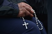 A faithful prays in front of Carondelet presidential palace in Quito where Pope Francis is expected to make a courtesy visit to Ecuadorean President...