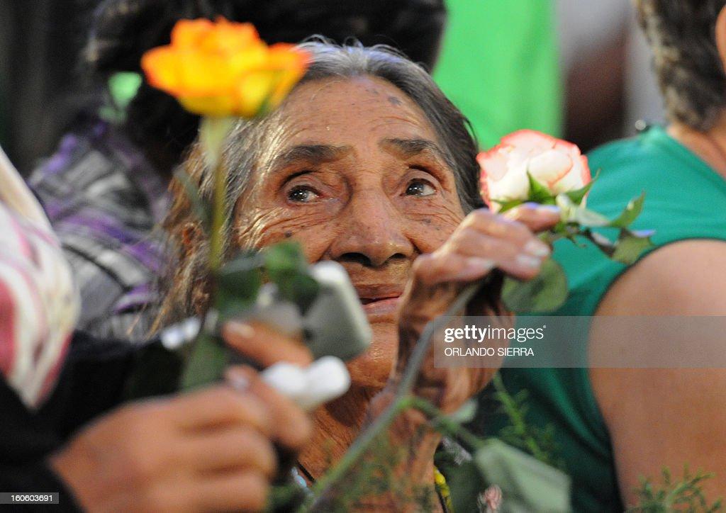 A faithful takes part in the celebration of the festival of the Holy Virgin of Suyapa, Honduras' patron saint, in Tegucigalpa, on February 3, 2013. AFP PHOTO/Orlando SIERRA.