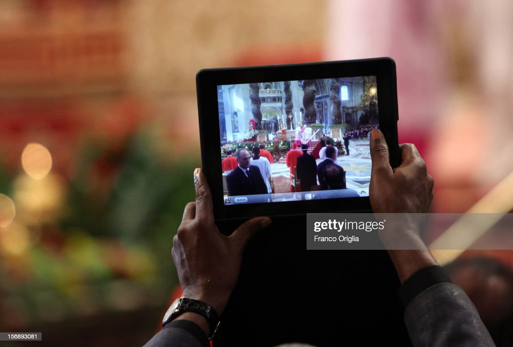 A faithful takes pictures with an iPad during a concistory held by Pope Benedict XVI at Saint Peter's Basilica on November 24, 2012 in Vatican City, Vatican. The Pontiff installed 6 new cardinals during the ceremony, who will be responsible for choosing his successor.