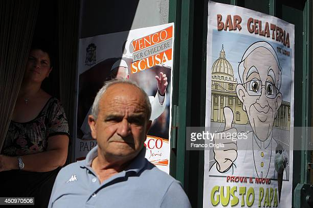 Faithful wait for the Pope Francis arrival in front of a banner reading 'I Come to ask forgiveness' on June 21 2014 in Cassano allo Jonio Cosenza...