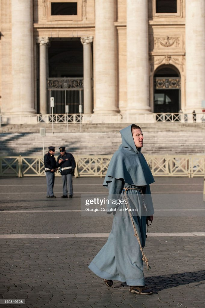 A faithful walks in St. Peters' Square on February 19, 2013 in Vatican City, Vatican. Pope Benedict XVI will hold his last weekly public audience on February 27 at St Peter's Square after announcing his resignation earlier last week.