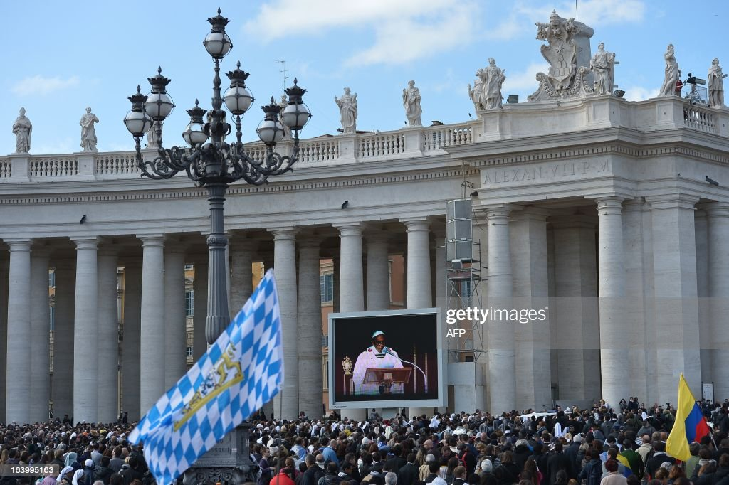 Faithful watch the inauguration mass of Pope Francis on a giant screen at St Peter's square on March 19, 2013 at the Vatican. World leaders flew in for Pope Francis's inauguration mass in St Peter's Square on Tuesday where Latin America's first pontiff will receive the formal symbols of papal power.