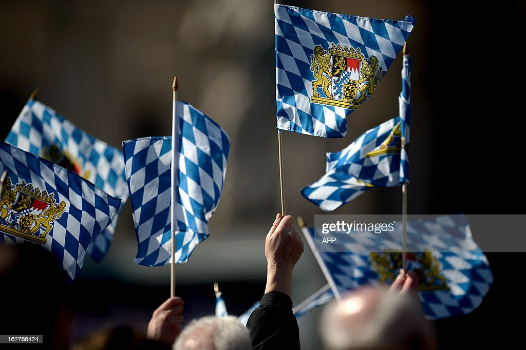 Faithful waves flags from Bavaria during Pope Benedict XVI's last weekly audience on February 27, 2013 at St Peter's square at the Vatican. Pope Benedict XVI will hold the last audience of his pontificate in St Peter's Square on Wednesday on the eve of his historic resignation as leader of the world's 1.2 billion Catholics. AFP PHOTO / FILIPPO MONTEFORTE