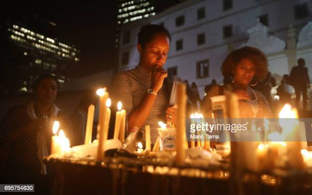 Faithful worship with candles at the annual feast of Saint Anthony of Padua at the Santo Antonio convent on June 13 2017 in Rio de Janeiro Brazil...