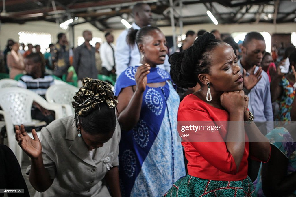 Faithfuls attend the Sunday church service at the rebuilt Evangelistic Assemblies of God in Zanzibar on November 23, 2013. Hundreds of supporters of separatist Islamist group Uamsho set fire to the church in May 2012 following protests against the arrest of senior members of the movement. This popular tourist paradise is facing rising concerns over the the specter of radical Islam after a spate of church burnings, riots, acid attacks and assassinations rock the island.