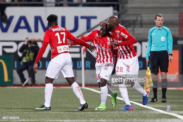 Faitout Maouassa of Nancy and Julien Cetout of Nancy and Issiar Dia of Nancy celebrates scoring his goal during the Ligue 1 match between As Nancy...