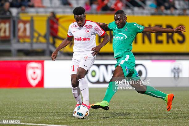Faitout Maouassa of Nancy and Mickael Nade of Saint Etienne during the Ligue 1 match between AS NancyLorraine and AS SaintEtienne at Stade Marcel...