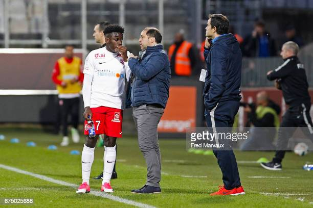 Faitout Maouassa of Nancy and Pablo Correa coach of Nancy during the French Ligue 1 match between Metz and Nancy at Stade SaintSymphorien on April 29...