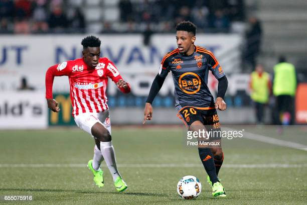 Faitout Maouassa of Nancy and Steven Moreira of Lorient during the French League match between Nancy and Lorient at Stade Marcel Picot on March 18...
