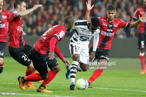 Faitout Maouassa of Rennes and Ludovic Blas of Guingamp during the Ligue 1 match between EA Guingamp and Stade Rennais at Stade du Roudourou on...