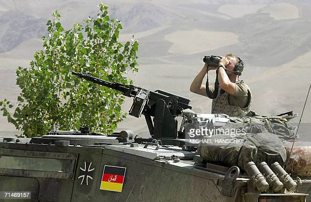A soldier of the German armed forces Bundeswehr observes the area at the airport of Faizabad northern Afghanistan 18 July 2006 The German contingent...
