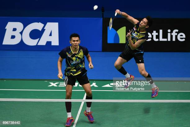 Fajar Alfian and Muhammad Rian Ardianto of Indonesia compete against Kittinupong Kedren and Dechapol Puavaranukroh of Thailand during Mens Double...