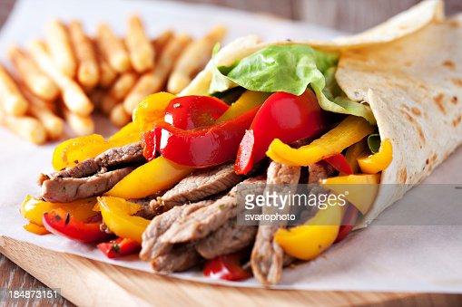 Fajitas with fries : Stock Photo