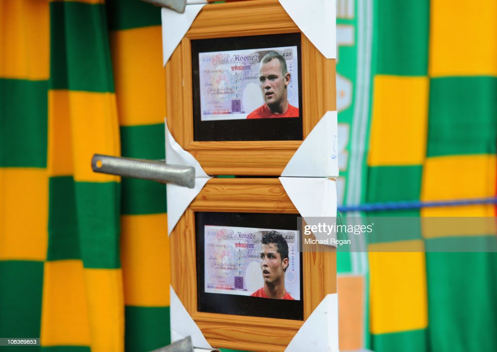 Fake bank notes featuring Wayne Rooney and Cristiano Ronaldo for sale outside the ground before the Barclays Premier League match between Manchester...