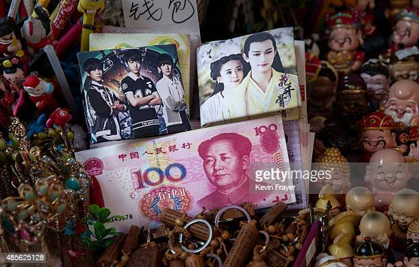 A fake Chinese banknote is seen in a market in a shopping district on August 28 2015 in Beijing China China's government is relying on domestic...