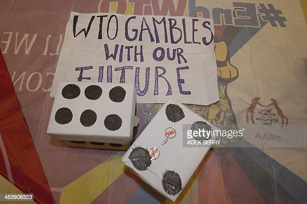 Fake dices are placed by activists from La Via Campesina while they holding a protest against WTO in front of the door of the venue of the 9th World...