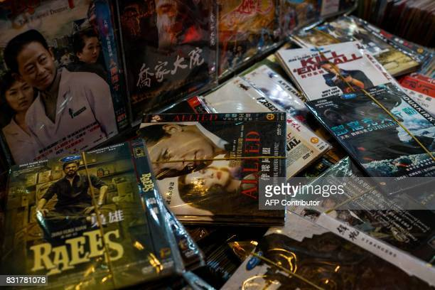 Fake DVD's of American movies are displayed for sale in Shanghai on August 15 2017 Trade tensions between the United States and China heated up on...