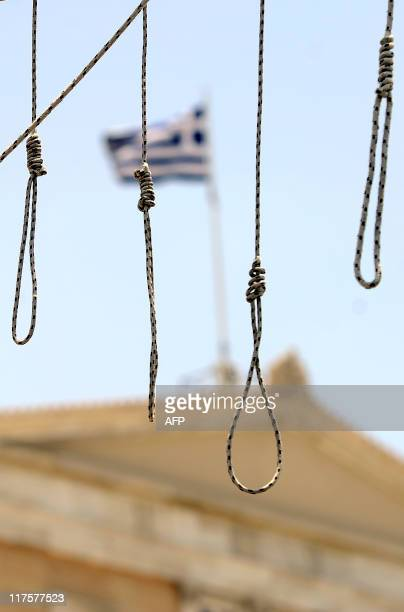 A fake gallows has been set by demonstrators in front of the Greek parliament on June 28 2011 in Athens during a protest part of the 48hour general...