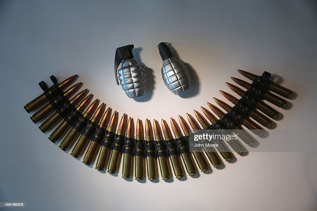 Fake grenades and ammunition is displayed after being confiscated at airport security checkpoints at the JFK International Airport on November 18...